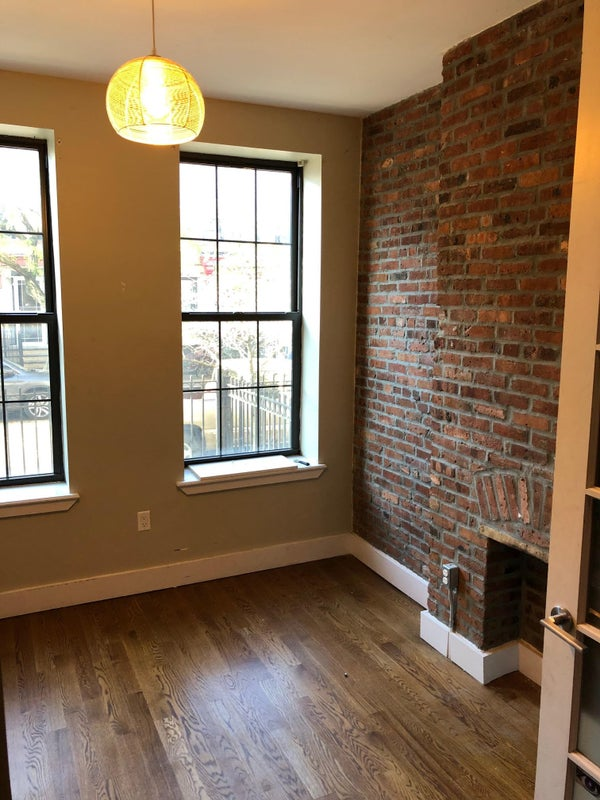 Photo 1: Room A - $900 w/ Exposed Brick